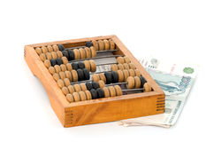 Abacuses. Old wooden abacuses and rouble notes. Close up Stock Image