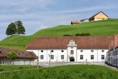 Abadía de Einsiedeln delante de tierras de labrantío Imagen de archivo libre de regalías