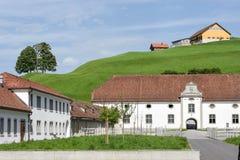 Abadía de Einsiedeln delante de tierras de labrantío Imagen de archivo