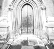abadía del weinstmister en puerta de la iglesia de Londres y antigüedad viejas del mármol Imágenes de archivo libres de regalías