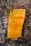 Abadejos ahumados con tomillo, el grano de pimienta y la sal Imagen de archivo libre de regalías