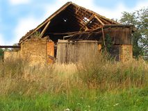 Abadoned barn ruin on the edge of the village. Old dilapidated farmhouse Royalty Free Stock Photo