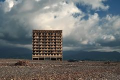 Abadoned building at the beach of the Kobuleti Georgia. Lonely abadoned building at the beach of the Kobuleti Georgia with small houses and mountains on the Royalty Free Stock Photography