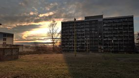 Abadoned building called Merkur. This abadoned building is in Czech republic in city called Havirov. It is sunset Stock Photos