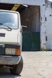 Abadoned car near deserted storage. Abadoned work car near deserted storage Royalty Free Stock Photo
