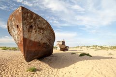 Abadoned ship in Aral Desert, Munyak, Karakalpakstan, Uzbekistan. Abadoned shipwreck in Aral Desert near Munyak Port on seabed of former Aral Sea, Munyak Royalty Free Stock Photography
