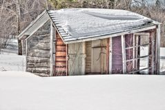 Abadoned Vermont Shed. Quaint, old Vermont shed surrounded by deep snow Stock Photos