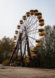 Abadonrd ferris wheel in Pripyat ghost town in Chernobyl exclusi Stock Photos