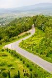 Abajo camino de la colina Imagen de archivo libre de regalías