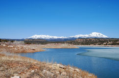 Abajo Mountains And Winter Lake In Utah Stock Photo