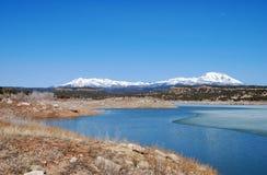 Abajo Mountains and winter lake in Utah Stock Photo