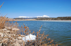 Abajo Mountains and winter lake in Utah Stock Images