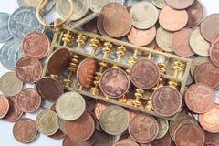 Abakus- und Geldmünze Lizenzfreie Stockfotos