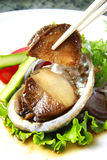 Abalone. With vegetable on the dish Royalty Free Stock Photo