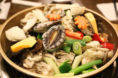 Abalone hot pot called the nobility of the sea with mushroom, pu Stock Photos