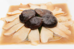 Abalone slices in red sauce Stock Images