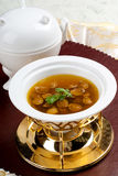 Abalone Soup. Abalone - In China, the abalone is often referred to as \ gem \. Similar to the shark's fin or bird's nest soup, it is considered a symbol of Royalty Free Stock Photography