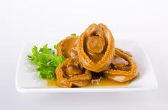 Abalones. Chinese cuisine abalone on background. Stock Photos