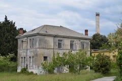 An abandoend building slowly falling apart. Stock Photo