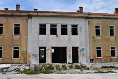An abandoend building slowly falling apart. Royalty Free Stock Image