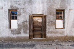 Abandon Backdoor Background. Horizontal Photo of a background of a backdoor and windows to an abandon building stock photos