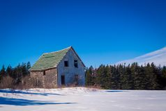 Abandon barn in the winter. In Prince Edward Island royalty free stock image