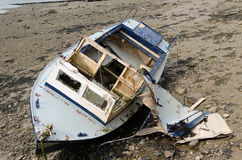 Abandon Boat on the sea front. Royalty Free Stock Image