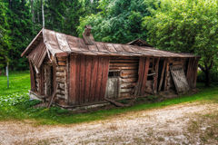 Abandon collapsed log cabin. A photo of an old abandon collapsed log cabin with a tin rook and chimney in forest royalty free stock images