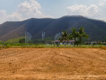 Abandon Cultivated Land Area Contrast with Abundance Area in Background. In Sunny Day Royalty Free Stock Photos