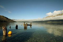 Abandon Dock. Clear lake and abandon dock in front of New Zealand Mountains royalty free stock image