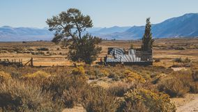 Abandon Farm. In the middle of the desert. Surrounded by a beautiful landscape - California royalty free stock photo