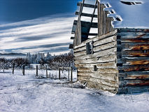 Abandon Farm Building Photo-Art. Abandoned farm building and fence in snowy winter Canada Photo-art stock illustration