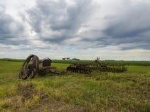 Abandon Farm Equipment in the fields Royalty Free Stock Photos