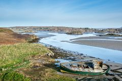 Abandon Fishing boat on the Sand 2. Abandon fishing boat reck  on the sand bank in Donegal Ireland Stock Photos