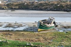Abandon Fishing boat on the Sand. Abandon fishing boat reck  on the sand bank in Donegal Ireland Stock Image