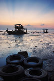 The abandon fishing boat at shore. The boat wreckh at shore at low Stock Images