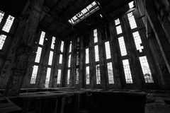 Abandon industrial interior. A desolate old industrial building inside, black and white Royalty Free Stock Image