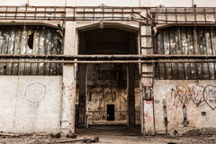 Abandon industrial interior. A desolate old industrial building inside, gate Royalty Free Stock Image