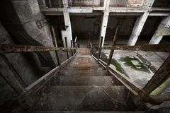 Abandon industrial interior. A desolate old industrial building inside, stair Stock Photos