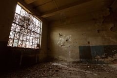 Abandon industrial interior. A desolate old industrial building room inside Royalty Free Stock Image