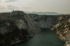 Abandon mine. Old mine and big lake in Thailand have a walk path along the cliff Royalty Free Stock Image