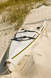 Abandon sea kayak. On an isolated tropical beach covered with sand stock photo