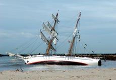 Abandon ship 2. Grounded tallship on sandbar royalty free stock photo