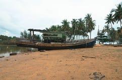 Abandon shipwreck near the sea shore under blue sky background a. Nd bright sun Stock Photo