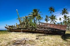 Abandon shipwreck near the sea shore under blue sky background a. Nd bright sun Stock Image