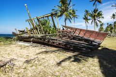 Abandon shipwreck near the sea shore under blue sky. Background and bright sun Royalty Free Stock Images