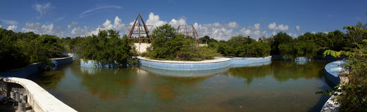 Abandon swimming pool and hot tubs (panoramic). Abandon swimming pool and hot tubs full of rain water serve as the perfect environment for mosquitoes to breed royalty free stock photo