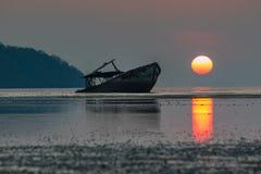 Abandon wreck boat and sun rising sky at phuket southern of thai Stock Photography