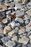 Abandonado lavado encima del zapato viejo Imagenes de archivo