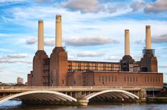 Abandonded Battersea Power Station and Grosvenor Bridge over the. Historical shot of decommissioned coal-fired Battersea power station, located on the south bank Stock Images